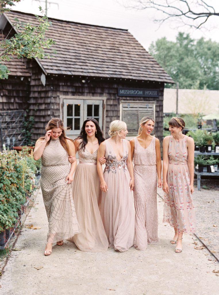 Bridesmaids in BHLDN dresses outside the Mushroom House at a Terrain at Styers wedding taken by Philadelphia Wedding Photographer Matt Genders Photography