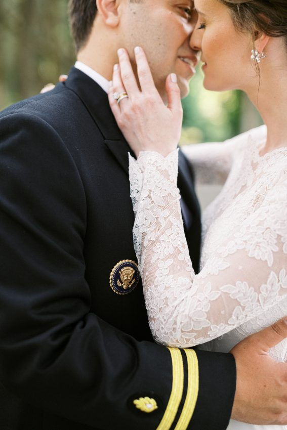 Bride with lace sleeves and groom embrace after wedding ceremony taken by Philadelphia Wedding Photographer Matt Genders