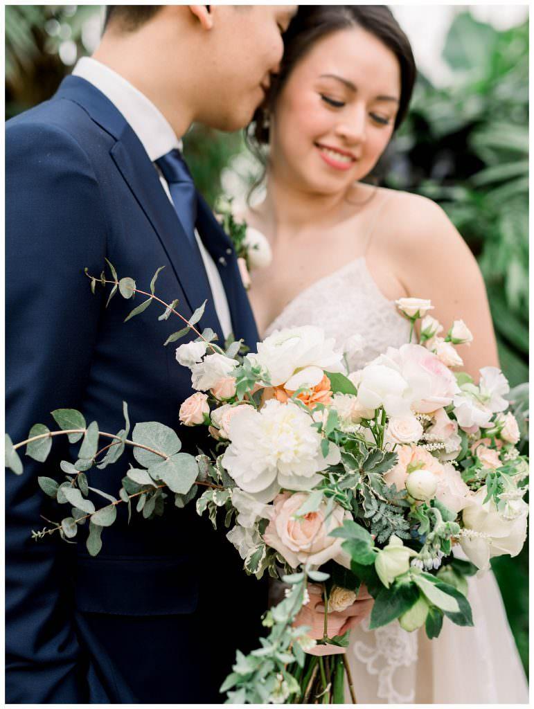 Bride and groom holding bouquet by Philadelphia Wedding Florist Devon & Pinkett by Philadelphia Wedding Photographer Matt Genders