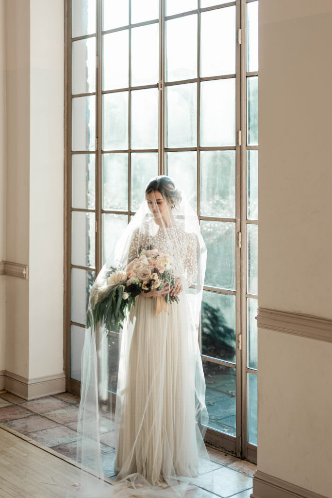 Bride wearing BHLDN dress with veil at Tyler Gardens holding bouquet by Belovely by Philadelphia Wedding Photographer Matt Genders