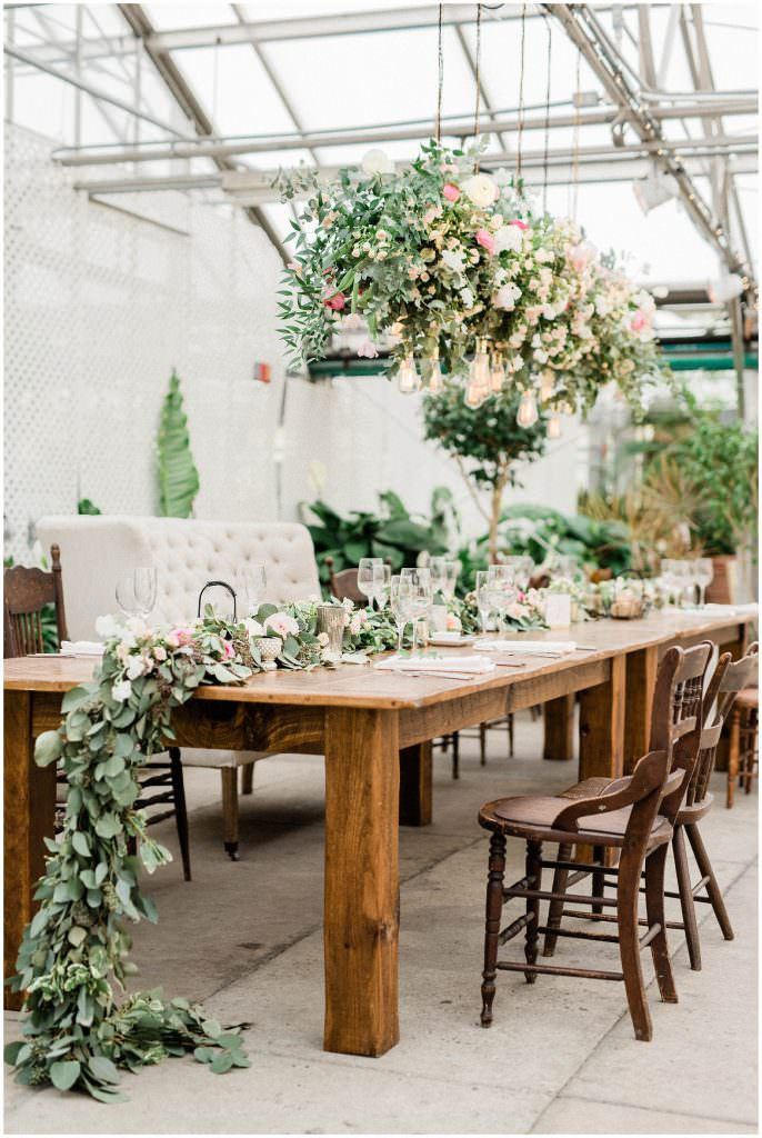 Cascading flowers off table at Fairmount Horticulture Center styled by the Styled Bride taken by Philadelphia Wedding Photographer Matt Genders