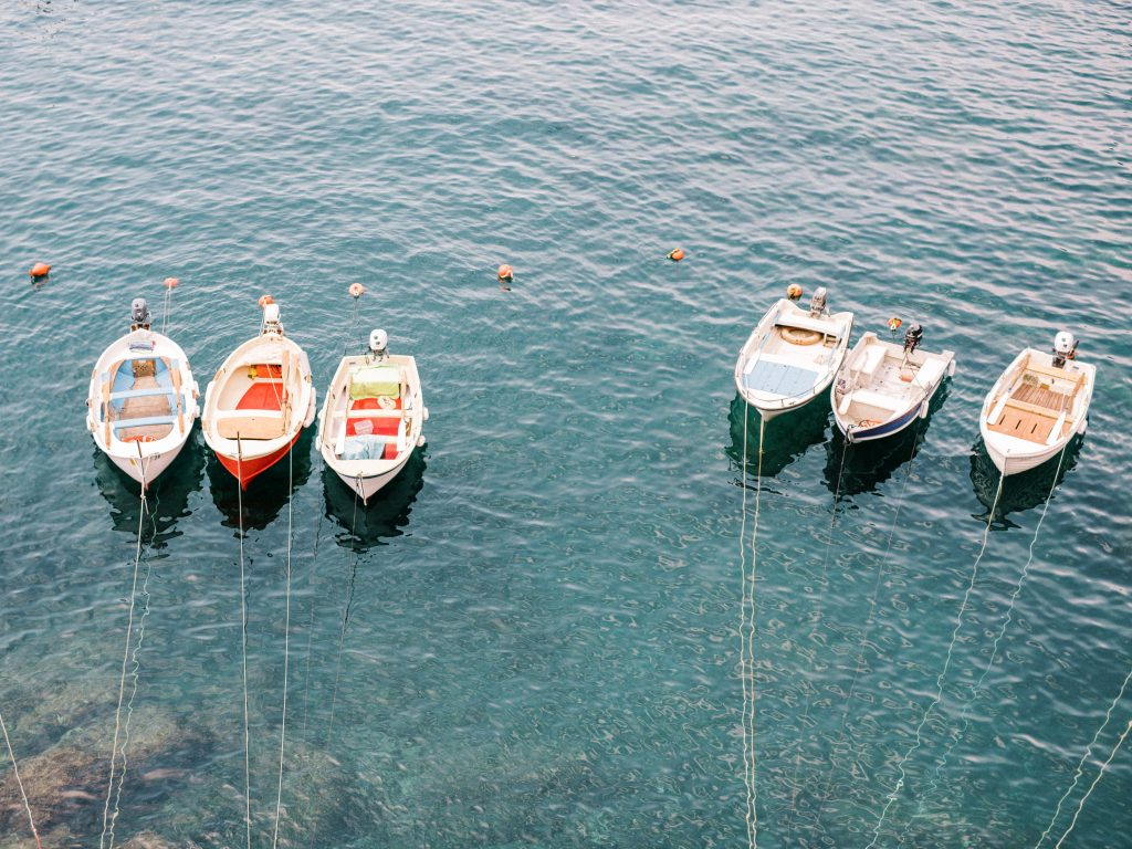 Boats lined up in the harbor of Vernazza Cinque Terre taken by landscape photographer Matt Genders