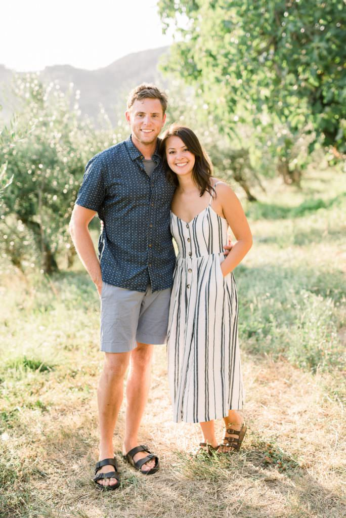 Philadelphia wedding photographer Matt Genders and Liz in blue shirt and shorts in olive grove in Tuscany, Italy