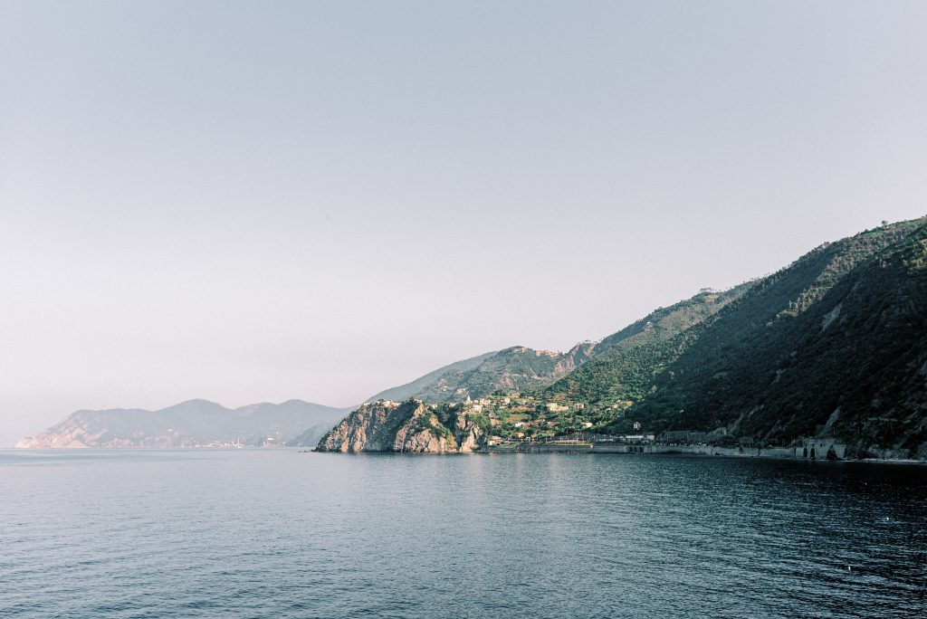 View of the five villages of Cinque Terre taken from the water taxi by landscape photographer Matt Genders