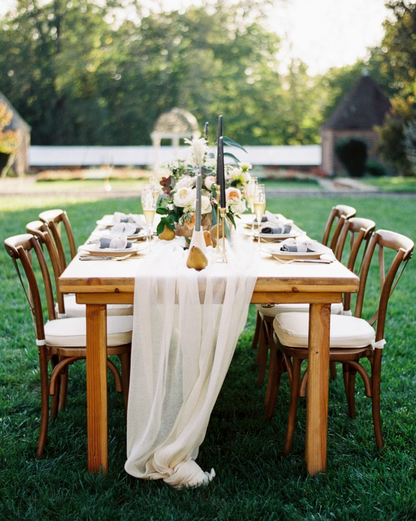 Wedding reception table set up in Tyler Gardens with florals by Belovely by Philadelphia Wedding photographer Matt Genders