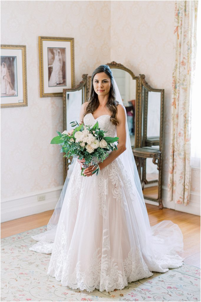 A bride with white and green bouquet at Cairnwood Estate taken by Philadelphia Wedding Photographer Matt Genders Photography