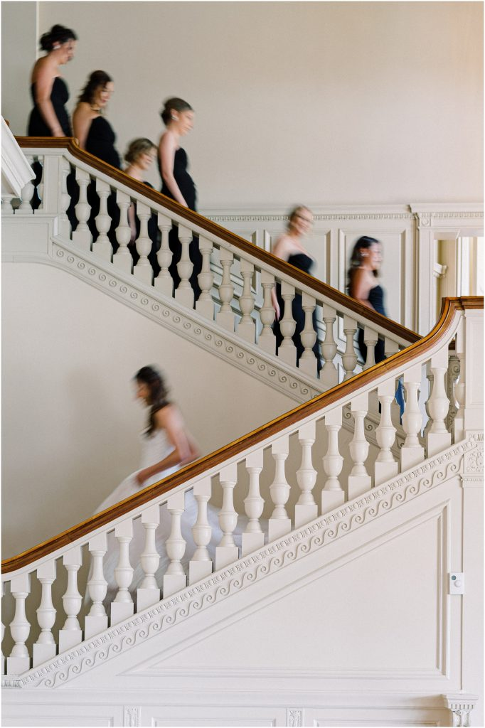 Bride and Bridesmaids descending the main staircase at Cairnwood Estate taken by Philadelphia Wedding Photographer Matt Genders Photography