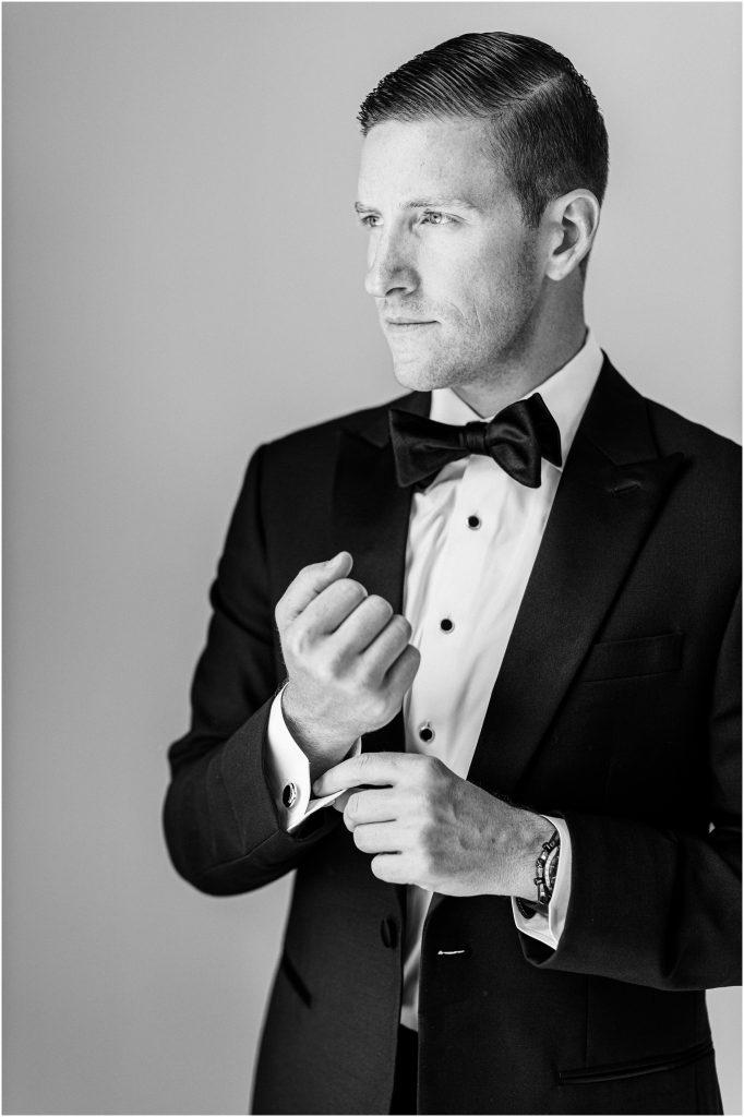 A Groom getting ready at Cairnwood Estate taken by Philadelphia Wedding Photographer Matt Genders Photography