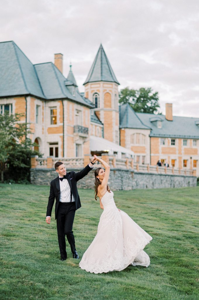 Bride in white dress and groom in tuxedo outside of Cairnwood Estate taken by Philadelphia Wedding Photographer Matt Genders Photography