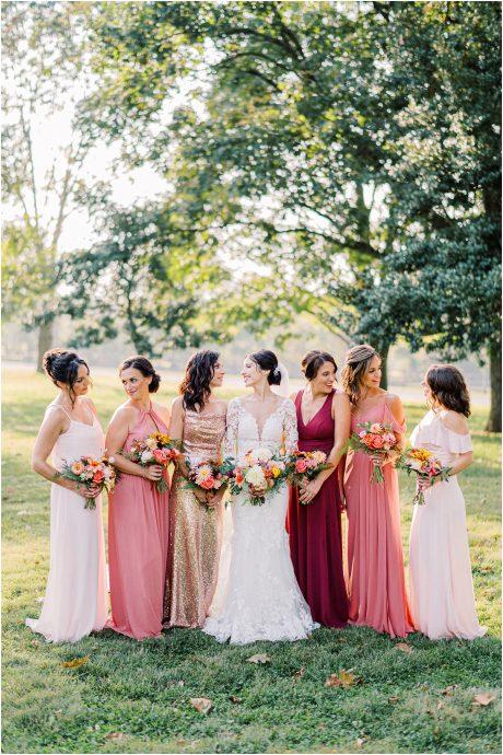Bridesmaids in vibrant pastels taken at golden hour at Springton Manor Farm taken by Philadelphia Wedding Photographer Matt Genders Photography