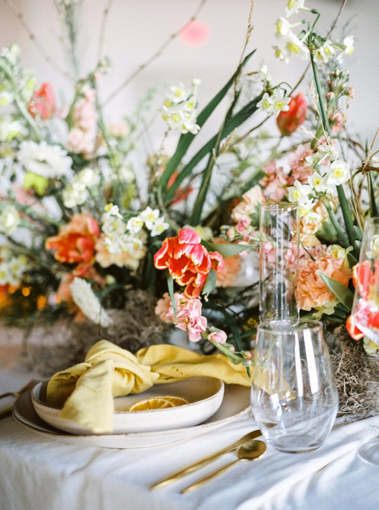 Red, white, and yellow florals cascading over a table at 500 Pearl in Buffalo NY taken by Philadelphia Wedding Photographer Matt Genders Photography