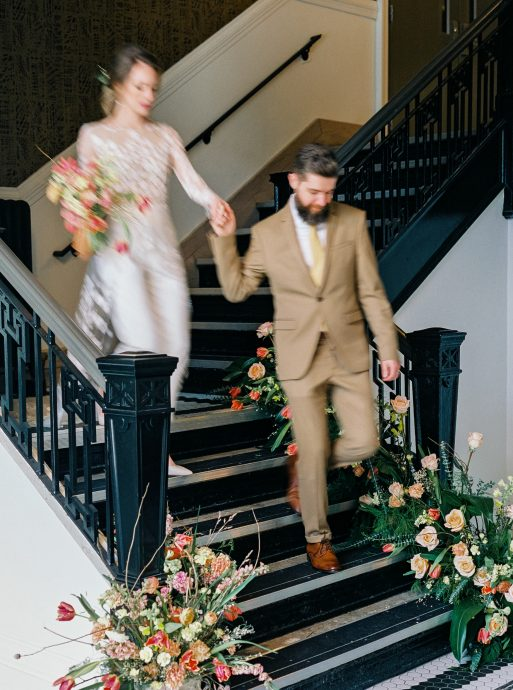Bride and groom descending a staircase at 500 Pearl in Buffalo NY taken by Philadelphia Wedding Photographer Matt Genders Photography