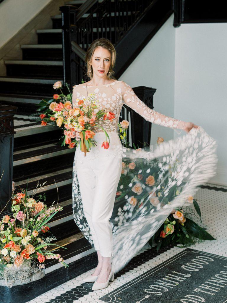 Bride in Rime Arodaky jumpsuit dress with vibrant bouquet taken by Philadelphia Wedding Photographer Matt Genders Photography