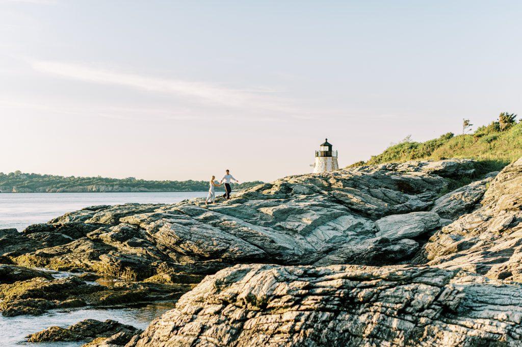 Bride and groom holding hands on rocks at Newport Rhode Island taken by Philadelphia Wedding Photographer Matt Genders