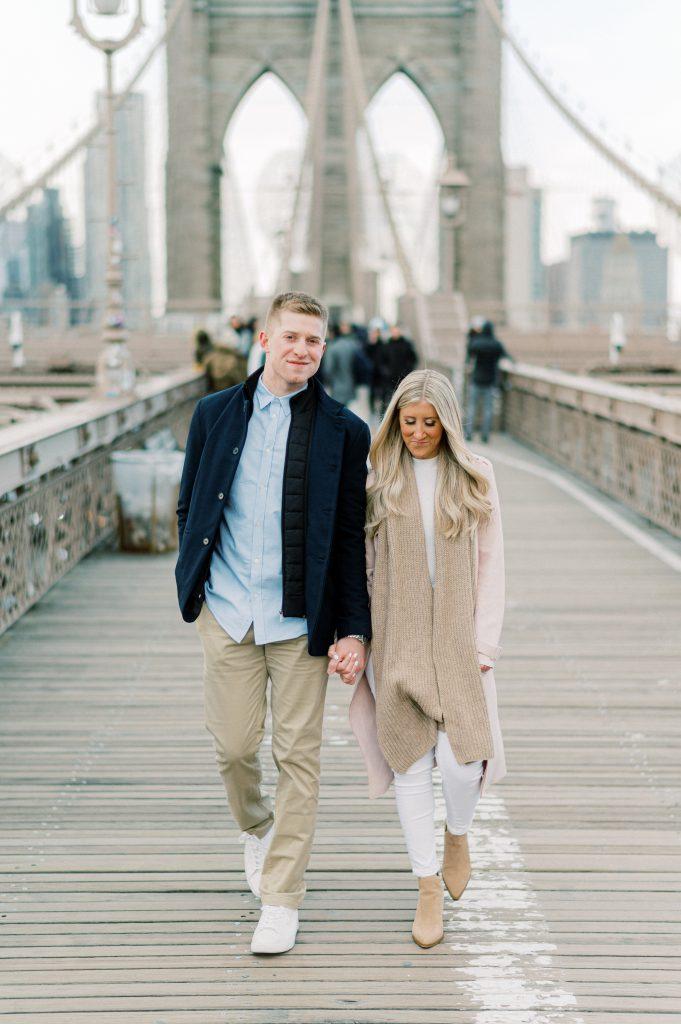 Bride and groom on Brooklyn Bridge during engagement session taken by Philadelphia Wedding Photographer Matt Genders