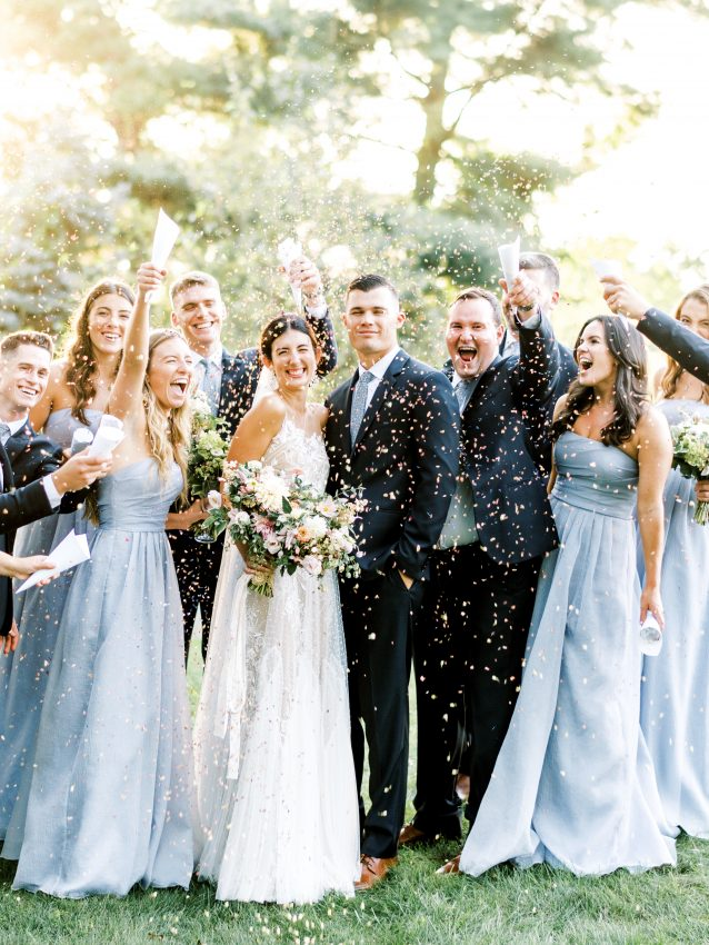 Bride and Groom with Bridal party cheering with confetti during golden hour at a backyard wedding in Philadelphia taken by Philadelphia wedding photographer Matt Genders