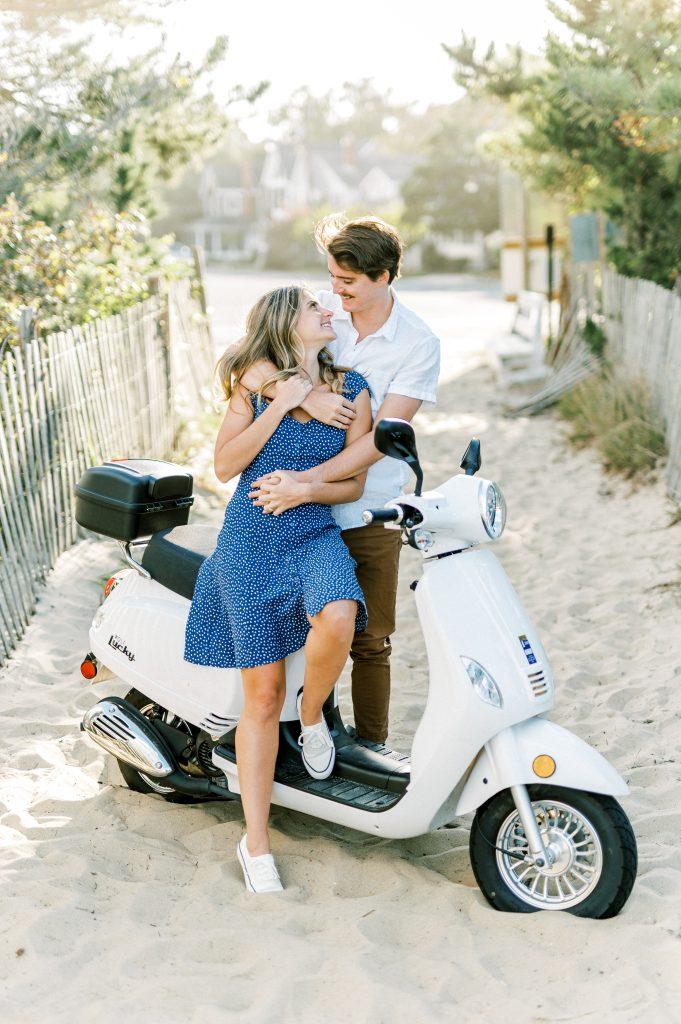 Couple embracing on white scooter at Rehoboth Beach taken by Philadelphia Wedding Photographer Matt Genders