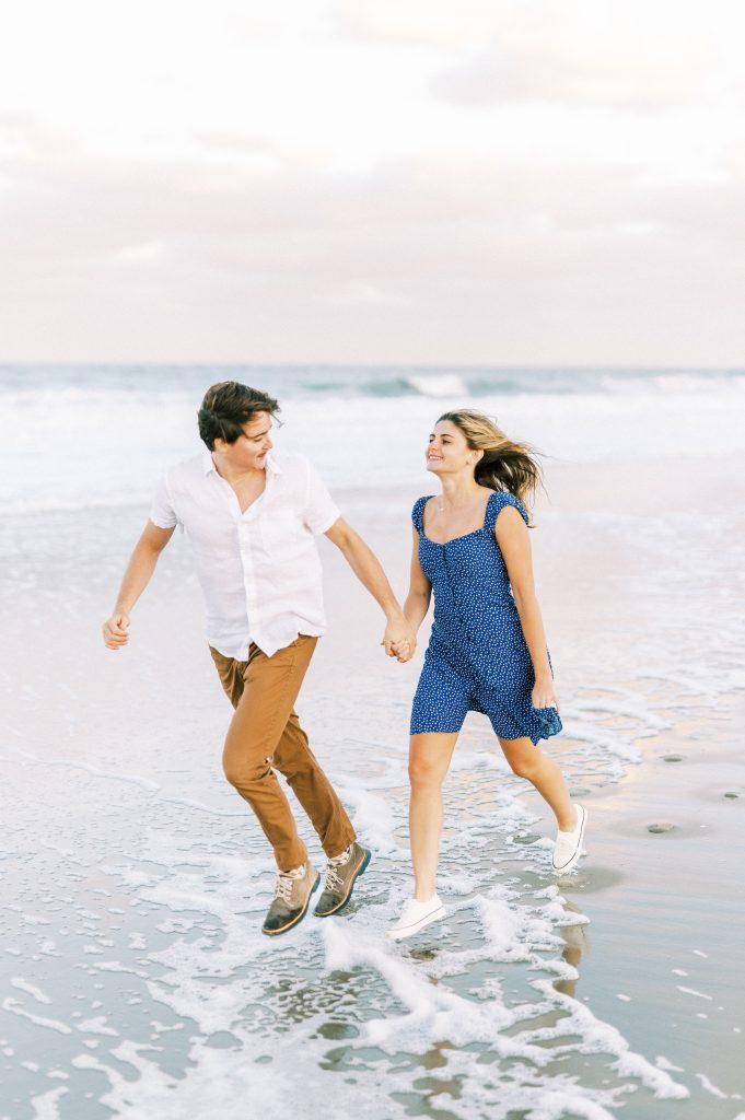 Couple next to the waves on Rehoboth Beach taken by Philadelphia Wedding Photographer Matt Genders