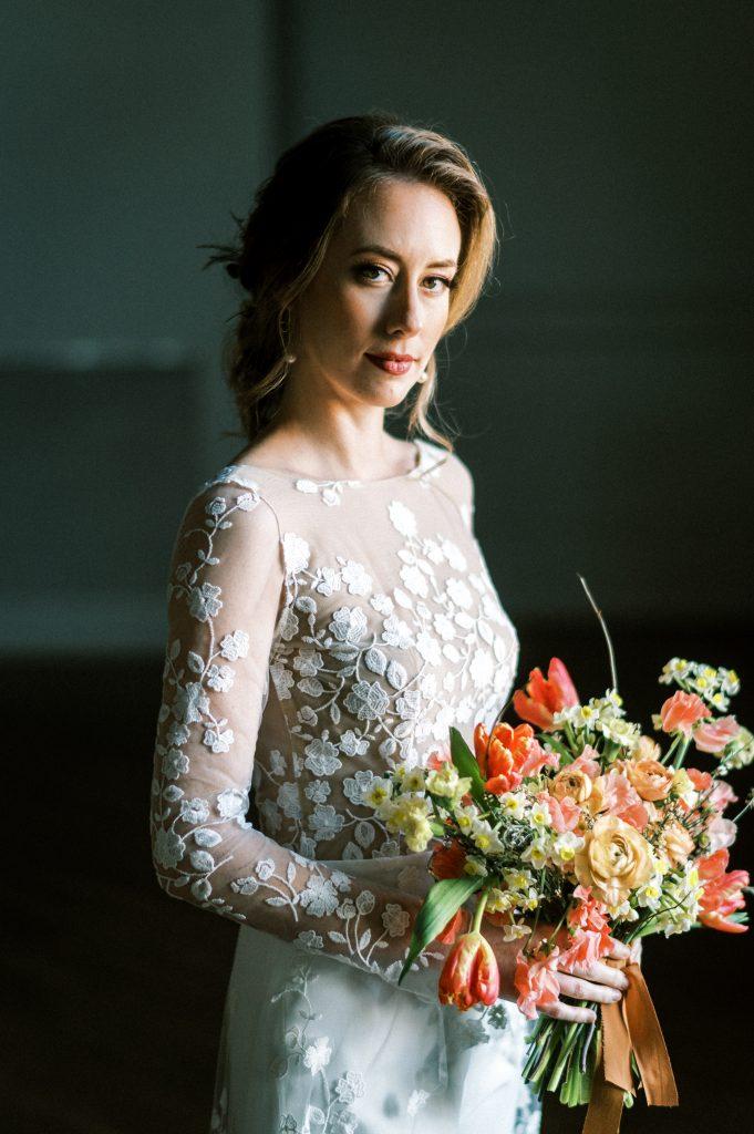 Bride holding bouquet in Rime Arodaky jumpsuit dress taken by Philadelphia Wedding Photographer Matt Genders Photography