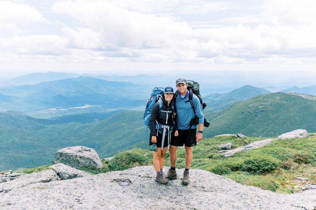 Backpackers standing on the summit of Mt. Marcy in the High Peaks taken by Philadelphia Wedding Photographer Matt Genders