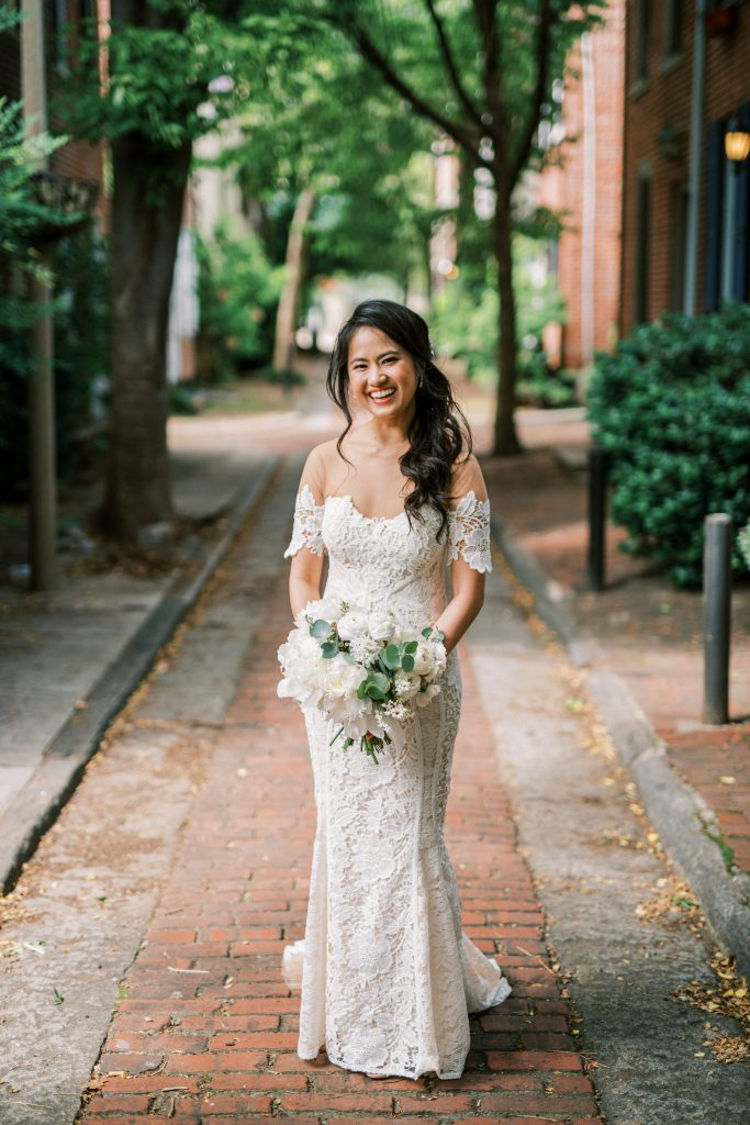 Bride holding all white bouquet by We Are Wildflowers in Philadelphia by Philadelphia Wedding Photographer Matt Genders Photography