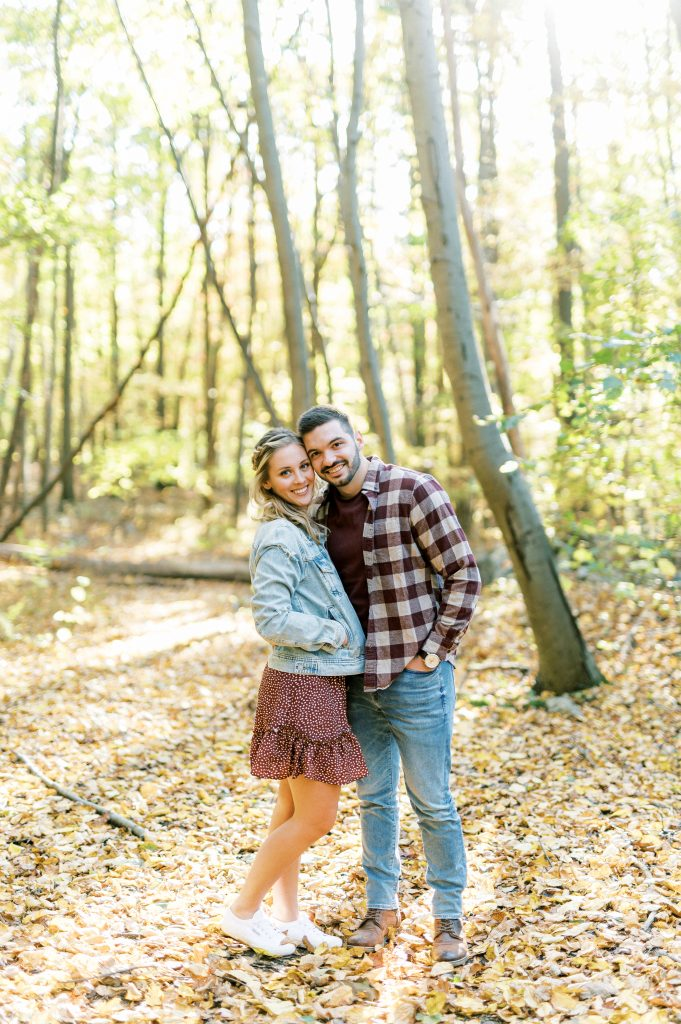 Bride in denim jacket and flannel in the woods at Hawk Mountain Sanctuary taken by Philadelphia Wedding Photographer Matt Genders Photography