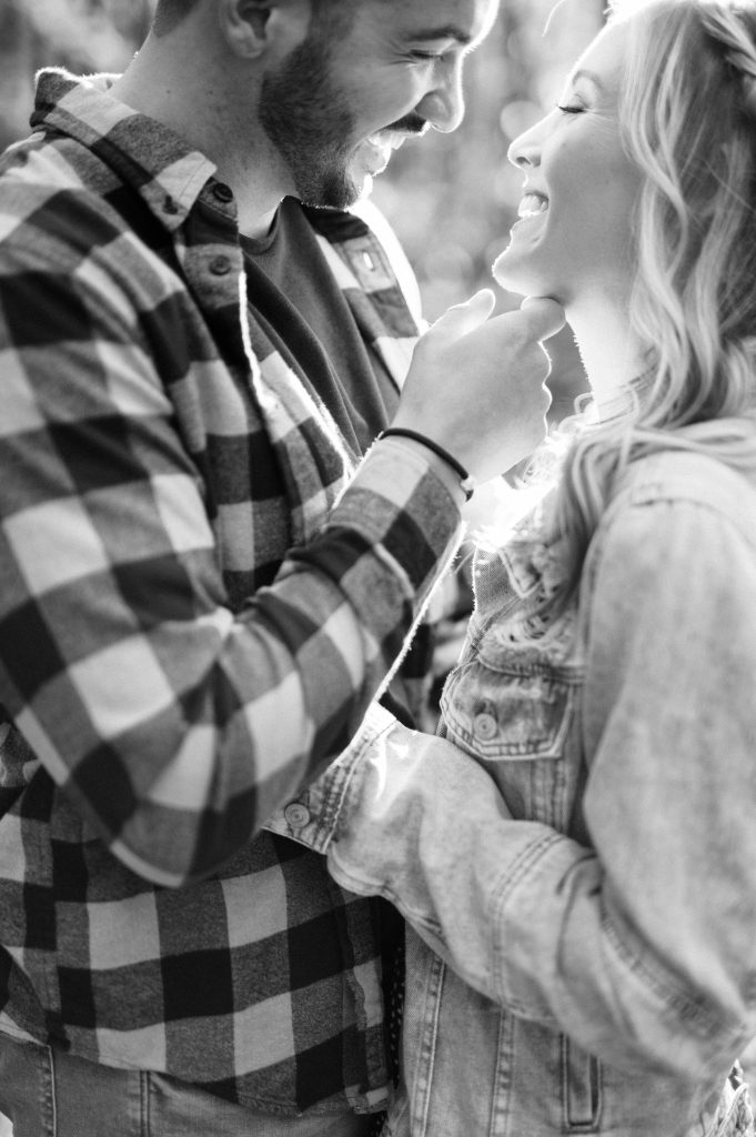 Bride in denim jacket and groom in flannel in the woods at Hawk Mountain Sanctuary taken by Philadelphia Wedding Photographer Matt Genders Photography