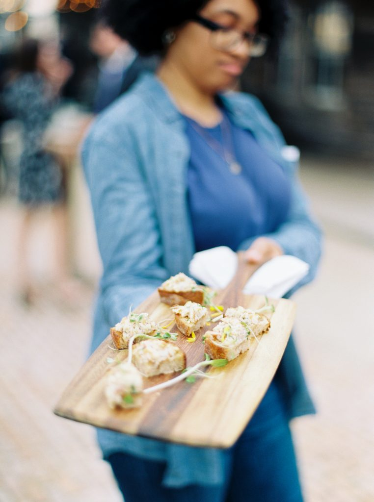 An appetizer on a wood board during a cocktail our at a Terrain at Styers Wedding taken by Philadelphia Wedding Photographer Matt Genders