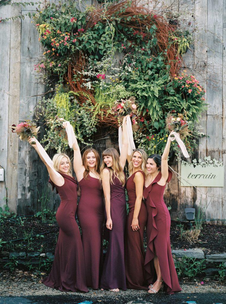 Bridesmaids in BHLDN dresses outside of Terrain at Styers taken by Philadelphia Wedding Photographer Matt Genders