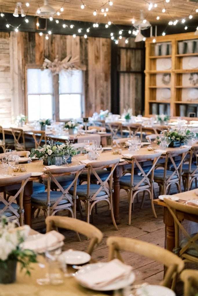 A reception set up with white bouquets at Terrain at Styers taken by Philadelphia Wedding Photographer Matt Genders Photography